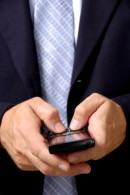 Man texting on a smart phone